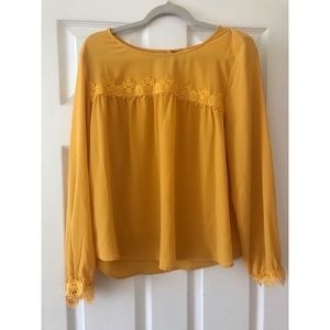 Yellow blouse.